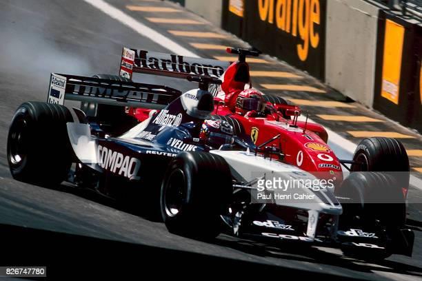 Juan Pablo Montoya Michael Schumacher WilliamsBMW FW24 Ferrari F2002 Grand Prix of Brazil Interlagos 26 March 2000