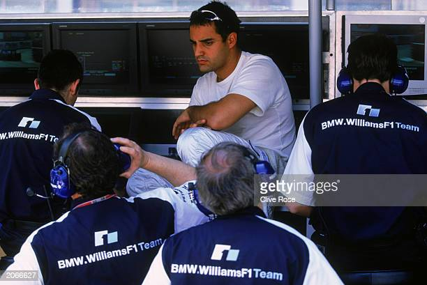 Juan Pablo Montoya of BMW-Williams sitting with the BMW-Williams team during the Monaco Formula One Grand Prix held on June 1, 2003 in Monte Carlo,...