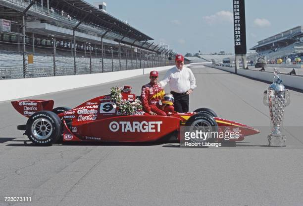 Juan Pablo Montoya of Colombia and team owner Chip Ganassi stand beside the Target Chip Ganassi Racing GForce GF05a Oldsmobile and the Borg Warner...
