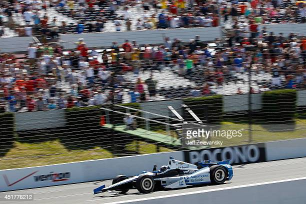 Juan Pablo Montoya of Colombia driver of the PPG Team Penske Chevrolet celebrates his victory in the Pocono INDYCAR 500 at Pocono Raceway on July 6...