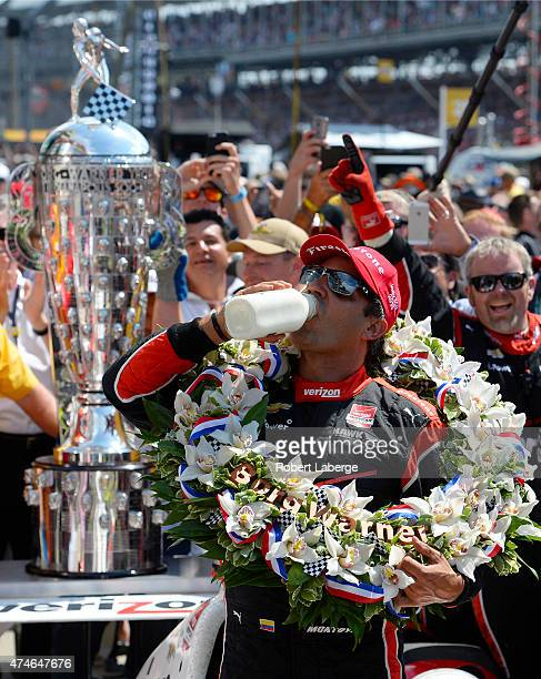 Juan Pablo Montoya of Colombia driver of the Team Penske Chevrolet Dallara celebrates winning the 99th running of the Indianapolis 500 mile race by...