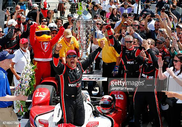 Juan Pablo Montoya of Colombia driver of the Team Penske Chevrolet Dallara celebrates after winning the 99th running of the Indianapolis 500 mile...