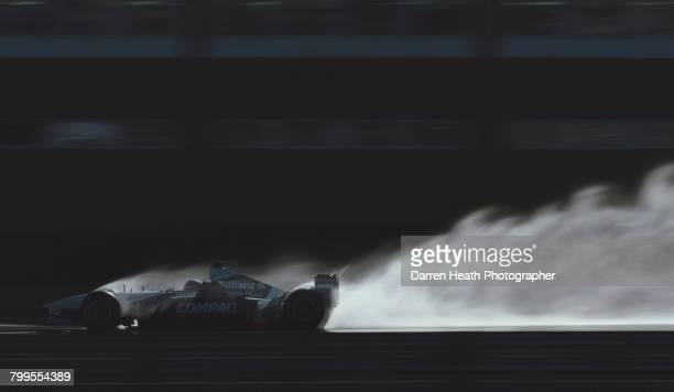 Juan Pablo Montoya of Colombia drives the BMW Williams F1 Team Williams FW24 BMW V10 in the simulated wet during Formula One pre season testing on 10...