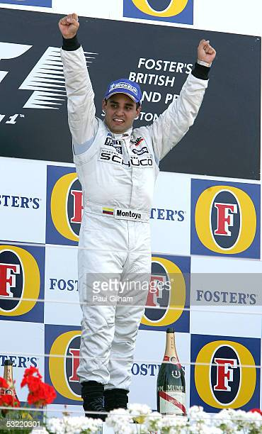 Juan Pablo Montoya of Columbia and McLaren Mercedes celebrates winning the British F1 Grand Prix at Silverstone Circuit on July 10 2005 in...