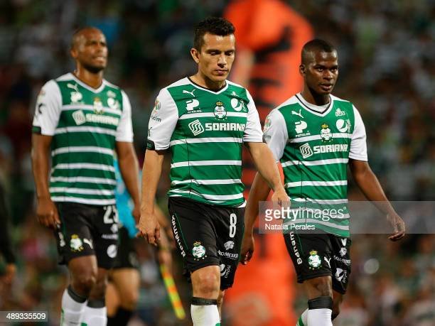 Juan Pablo Rodriguez and players of Santos leave the field after their team is knocked out during the Semifinal second leg match between Santos...