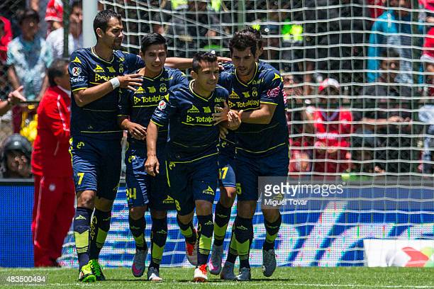 Juan Pablo Rodriguez of Morelia celebrates with his teammates after scoring the first goal of his team during a 3rd round match between Toluca and...
