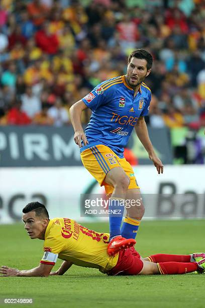 Juan Pablo Rodriguez of Morelia vies for the ball with Andre Pierre Gignac of Tigres during their Mexican Apertura 2016 tournament football match at...