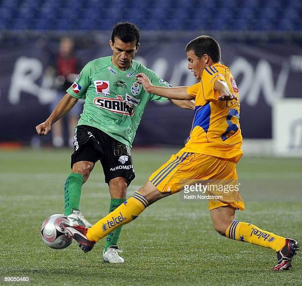 Juan Pablo Rodriguez of Santos Laguna has his pass broken up by Lucas Ayala of Tigres UANL during SuperLiga semifinal match at Gillette Stadium July...