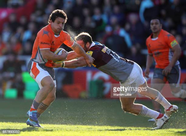 Juan Pablo Socino of Newcastle Falcons is tackled by Jamie Roberts of Harlequins during the Aviva Premiership match between Harlequins and Newcastle...