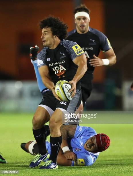 Juan Pablo Socino of Newcastle Falcons is tackled by Sebastian De Chaves of London Irish during the Aviva Premiership match between Newcastle Falcons...