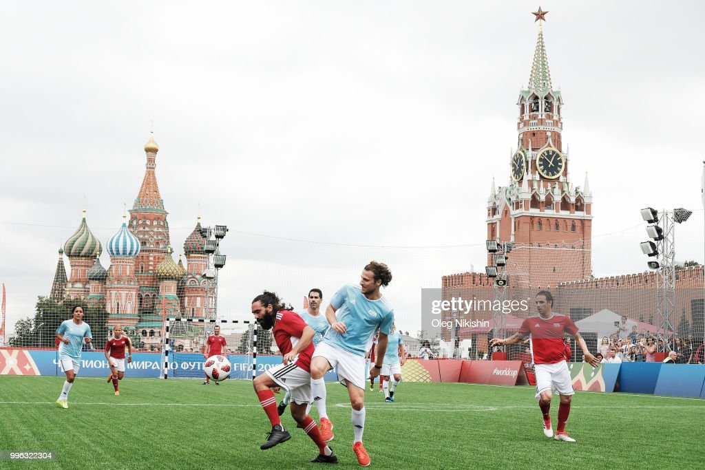 Juan Pablo Sorin (L) and Diego Forlan compete during the Legends Football Match in 'The park of Soccer and rest' at Red Square on July 11, 2018 in Moscow, Russia.