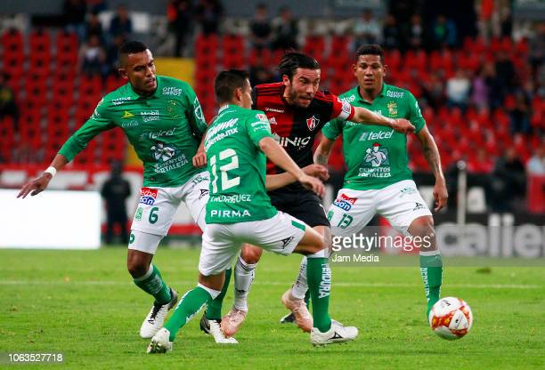 Juan Pablo Vigon of Atlas fight for the ball with William Tesillo Jose Rodriguez and Alexander Mejía of Leon during a 15th round match between Atlas...