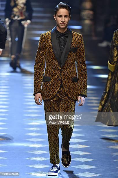 Juan Pablo Zurita walks the runway at the Dolce Gabbana show during Milan Men's Fashion Week Fall/Winter 2017/18 on January 14 2017 in Milan Italy