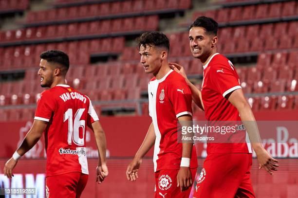 Juan Pedro 'Juanpe' Ramirez of Girona FC celebrates with his teammate Arnau Martinez after scoring his sides first goal during the Liga Smartbank...