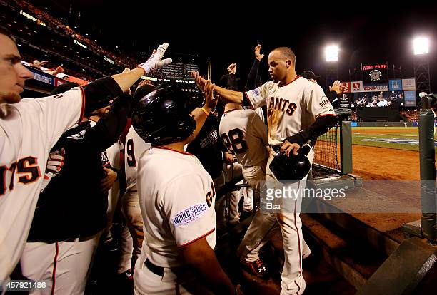 Juan Perez of the San Francisco Giants returns to the dugout after hitting a tworun RBI double in the eighth inning against the Kansas City Royals...