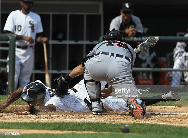 Juan Pierre of the Chicago White Sox is tagged out at home trying to score by Alex Avila of the Detroit Tigers at US Cellular Field on July 27 2011...