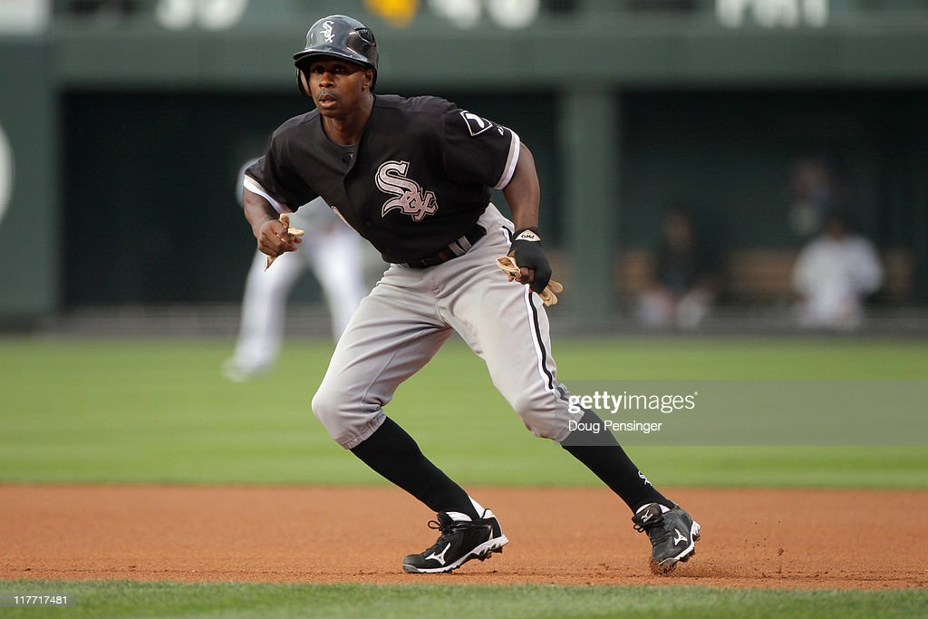 Juan Pierre #1 of the Chicago White Sox leads off of first base against the Colorado Rockies during Interleague play at Coors Field on June 29, 2011 in Denver, Colorado. The White Sox defeated the Rockies 3-2.