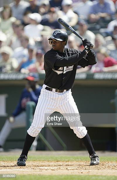 Juan Pierre of the Florida Marlins bats against the Minnesota Twins during their game on March 11 2004 at Roger Dean Stadium in Jupiter Florida The...