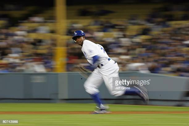Juan Pierre of the Los Angeles Dodgers runs the bases against the Pittsburgh Pirates at Dodger Stadium on April 16 2008 in Los Angeles California
