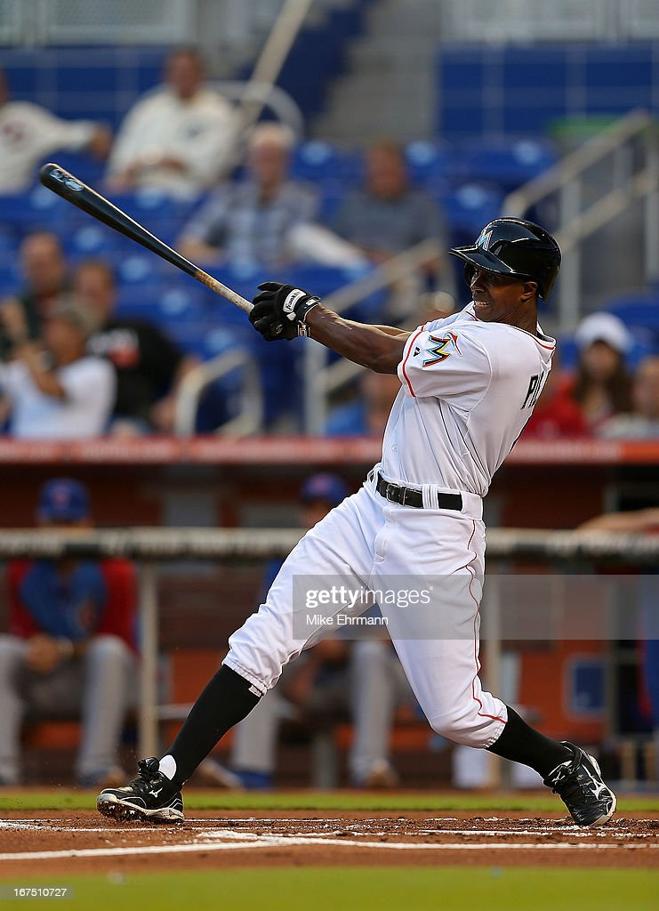 Juan Pierre #9 of the Miami Marlins hits during a game against the Chicago Cubs at Marlins Park on April 25, 2013 in Miami, Florida.