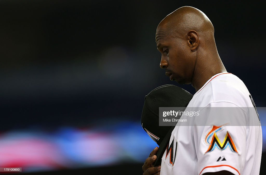 Juan Pierre #9 of the Miami Marlins looks on during a game against the New York Mets at Marlins Park on July 31, 2013 in Miami, Florida.