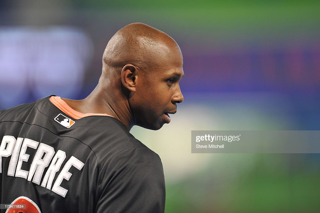 Juan Pierre #9 of the Miami Marlins looks on prior to a game against the Washington Nationals at Marlins Park on July 13, 2013 in Miami, Florida.