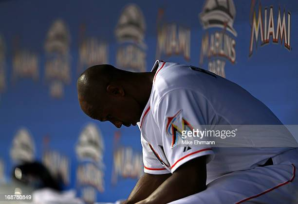 Juan Pierre of the Miami Marlins sits in the dugout during a game against the Cincinnati Reds at Marlins Park on May 14 2013 in Miami Florida