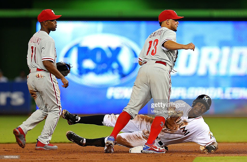 Juan Pierre #9 of the Miami Marlins slides into second as Freddy Galvis #13 of the Philadelphia Phillies turns a double play during a game at Marlins Park on May 21, 2013 in Miami, Florida.