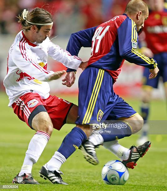 Juan Pietravallo of the New York Red Bull steals the ball from Clint Mathis of Real Salt Lake during the first half of MLS action at Rio Tinto...