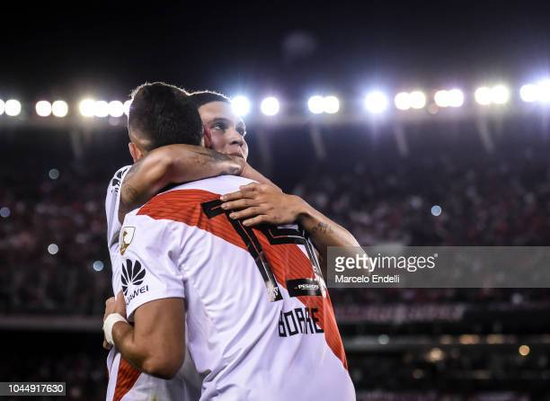 Juan Quintero celebrates with teammate Rafael Santos Borre of River Plate after scoring the second goal of his team during a quarter final second leg...