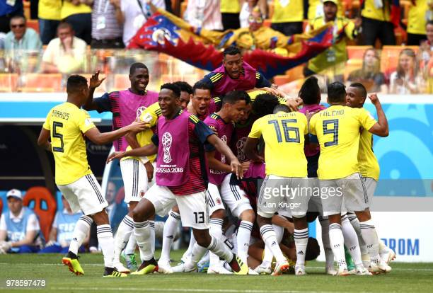 Juan Quintero of Colombia celebrates with team mates after scoring his team's first goal to make it 11 during the 2018 FIFA World Cup Russia group H...