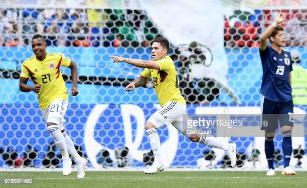 Juan Quintero of Colombia celebrates with teammate Jose Izquierdo after scoring his team's first goal during the 2018 FIFA World Cup Russia group H...