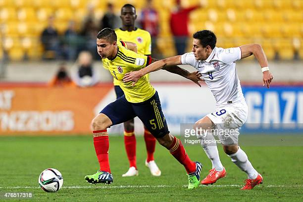 Juan Quintero of Colombia holds off the challenge of Rubio Rubin of USA during the FIFA U20 World Cup New Zealand 2015 Round of 16 match between USA...