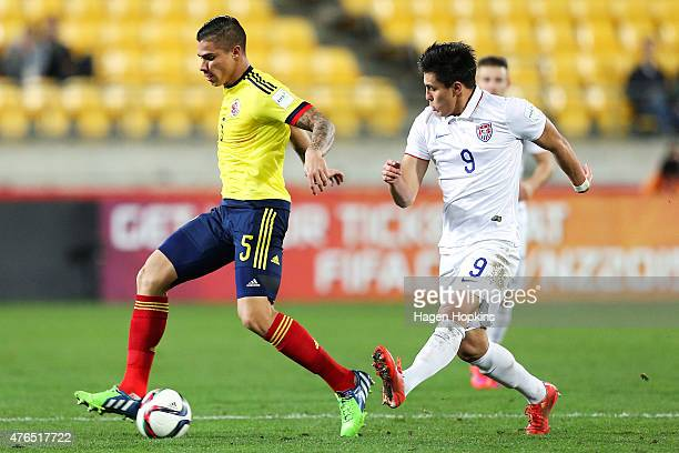 Juan Quintero of Colombia is challenged by Rubio Rubin of USA during the FIFA U20 World Cup New Zealand 2015 Round of 16 match between USA and...