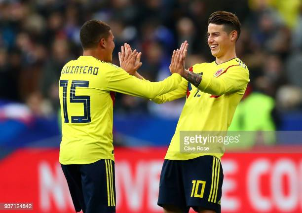 Juan Quintero of Columbia celebrates with teammate James Rodríguez after scoring his sides third goal during the International friendly match between...