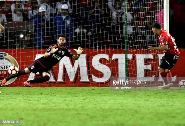 Juan Quintero of Deportivo Independiente Medellin scores the first goal of his team during a group stage match between Deporivo Independiente...