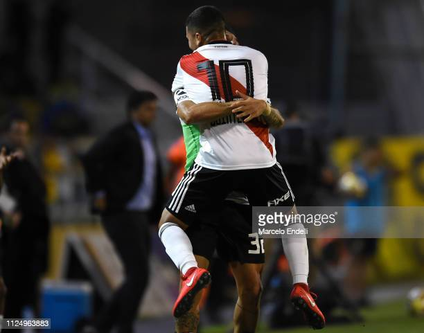Juan Quintero of River Plate celebrates with teammate Ignacio Scocco after scoring the first goal of his team during a match between Rosario Central...