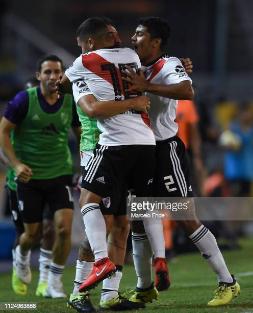 Juan Quintero of River Plate celebrates with teammates Ignacio Scocco and Robert Rojas after scoring the first goal of his team during a match...