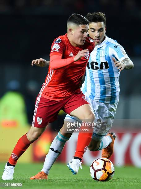 Juan Quintero of River Plate fights for the ball with Renzo Saravia of Racing Club during a round of sixteen first leg match between River Plate and...