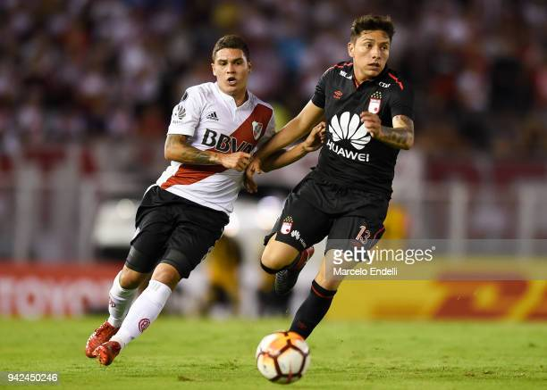 Juan Quintero of River Plate fights for the ball with Sebastian Salazar of Independiente Santa Fe during a Copa CONMEBOL Libertadores match between...