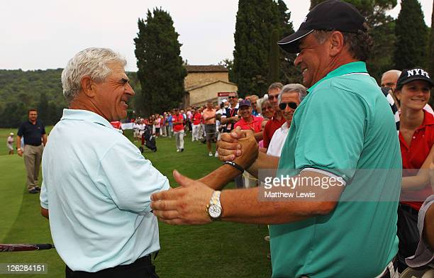 Juan Quiros of Spain is congratulated by Costantino Rocca of Italy after winning the Cannes Mougins Masters at the Golf Country Club de Cannes Mougin...