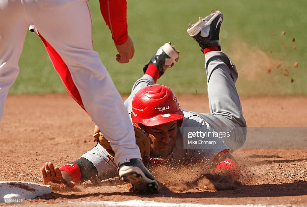 Juan Richardson #6 of the Dominican Republic is tagged out at first during a game against Panama during day 8 of the XVI Pan American Games at the Pan American Baseball Stadium on October 22, 2011 in Jalisco, Mexico.