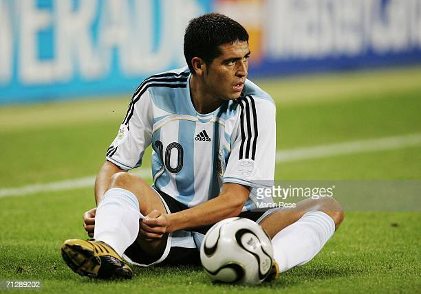 Juan Riquelme of Argentina adjusts his sock during the FIFA World Cup Germany 2006 Round of 16 match between Argentina and Mexico played at the...
