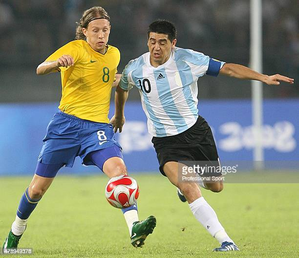 Juan Riquelme of Argentina and Lucas Leiva of Brazil in action during the Men's Football SemiFinal match between Argentina and Brazil at Workers'...