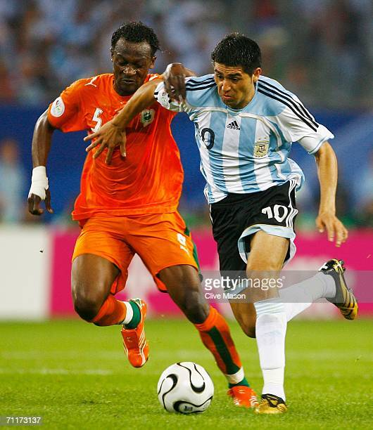 Juan Riquelme of Argentina fights for posession with Didier Zokora of Ivory Coast during the FIFA World Cup Germany 2006 Group C match between...