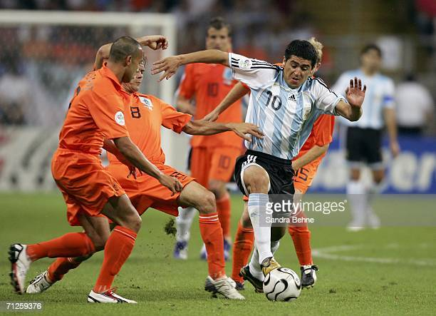 Juan Riquelme of Argentina holds off the Dutch defence during the FIFA World Cup Germany 2006 Group C match between Netherlands and Argentina at the...