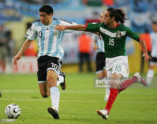 Juan Riquelme of Argentina is pursued by Jose Antonio Castro of Mexico during the FIFA World Cup Germany 2006 Round of 16 match between Argentina and...