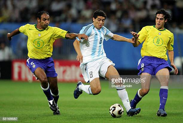 Juan Riquelme of Argentina tussles with Emerson and Kaka of Brazil during the FIFA 2005 Confederations Cup Final between Brazil and Argentina at the...