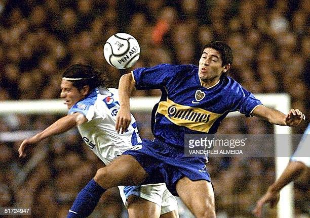 Juan Riquelme of Argentina's Boca Juniors fights for the ball with Clemente Rodriguez of Mexico's Cruz Azul 28 June 2001 during the finals of the...