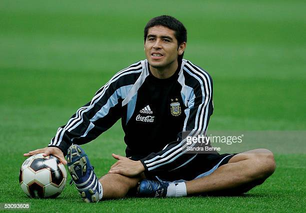 Juan Riquelme stretches on the grass during the Argentina National Team training session for the FIFA Confederations Cup on June 17 2005 in Nuremberg...